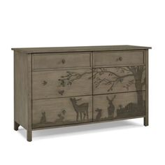 Give your nursery a relaxed look with the rustic-inspired styling of the Forest Animal Nursery Furniture Collection by ED Ellen DeGeneres. The Forest Animal Double Dresser boasts 6 roomy drawers, gorgeous etched forest scene, and rich acorn pulls.