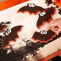 PLACE YOUR BATS    Sugar cookie dough is rolled out and cut into bat shapes for this Halloween treat. A dip in chocolate gives these critters their spooky, dark appearance.