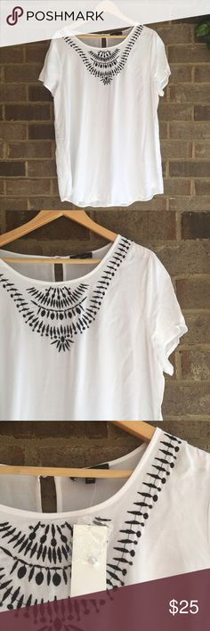 """NWT Spense Embroidered Rayon Top Made from rayon, this short sleeve top by Spense is great for everyday wear. The embroidered detail really makes the piece. In great condition. Approximate measurements lying flat: Bust 22"""", Length 20.5"""" 10555 Spense Tops Blouses"""