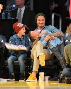 : David Beckham clowned around courtside with his sons Cruz and Romeo during a Lakers game in November 2012.