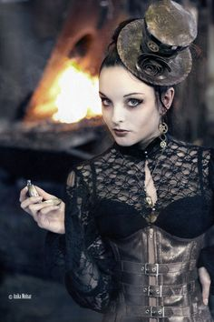 Steampunk beauty with bronze leather buckled bustier mixed with Victorian black lace.