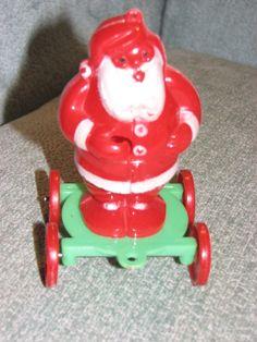 Vintage 1950s Christmas Rosbro Hard-Plastic SANTA on wheels toy