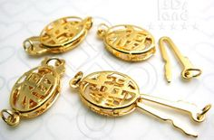 B613GD / 2 Sets / 12 x 9 x 2.5 mm - Gold Plated 1 Strand Oval Filigree Box Clasp with Chinese Auspicious Letter. $2.50, via Etsy.