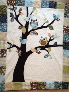 Colorful border, white center with tree and colorful leaves. Owl Baby Quilt