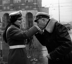 It's International Women's Day. A carnation and a hand kiss to a policewoman