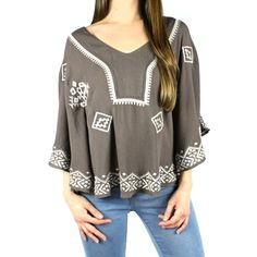 This cocoa gauze peasant top features cream tribal embroidery around the  hem and neckline. Two seams up each side separate the sleeve from the body  on this circle style top. Pair it with distressed boyfriend jeans or  cutoffs and your favorite wedges. A R+C must-have! Model is wearing size  small.    Rayon  Dry Clean Only