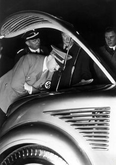 netnazi:  You sure no one will notice the emissions problem?   Schaub, Deiter and Albert Bormann looking on. This is the Berlin car show of 1938. Hitler attended all of these car shows from 1933-1939.