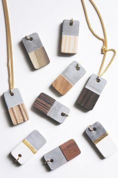 DIY Concrete and Wood Veneer Necklace Tutorial from Tinker Paint Bake Cakes.Make these modern DIY Concrete and Wood Veneer Necklaces using silicone jewelry molds. There isn't much of a tutorial, but m(Diy Necklace Tutorial) Cement Jewelry, Wooden Jewelry, Clay Jewelry, Jewellery Box, Fine Jewelry, Recycled Jewelry, Jewellery Earrings, Jewelry Model, Jewelry Stand