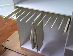 Picture of Sliding pants rack for the closet. Ladies can also hang their silky dresses over these as well