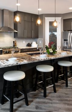 Morrison Homes is a Calgary Home Builder, specializing in front garage homes, luxury estate, quick possession homes & townhomes. Visit a show home today! Kitchen Redo, Kitchen Backsplash, Kitchen Cabinets, Calgary News, Morrison Homes, Luxury Estate, Studio Mcgee, Kitchen Pendants, Home Builders