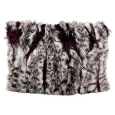 Add an indulgent touch of style to your sofa or favorite reading nook with this cozy faux fur pillow.  Product: Pillow