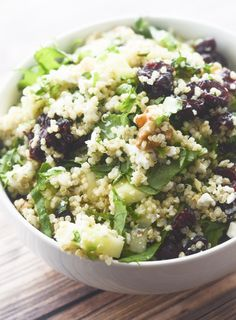 Kale and Quinoa Salad with Dried Cranberries, Walnuts, Feta Cheese, and whatever dressing you want!
