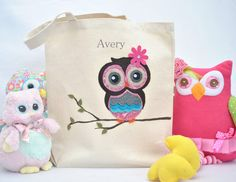 An artful layering of fabrics and colors bring this cute and whimsical owl alive on this canvas tote bag.  It features a cotton and felt appliquéd owl