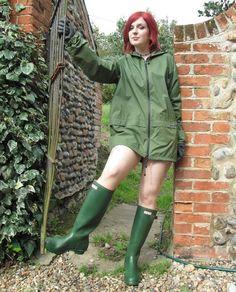 Redhead in green rain jacket and wellies