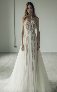 Gorgeously unique embroidered strapless wedding dress with tulle overskirt; Featured Dress: Ersa Atelier More