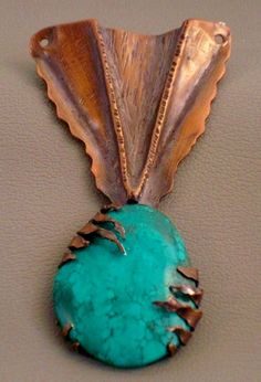 How to fold form a piece of copper sheet to create the base of this pendant. Students will also learn how to use a jeweler's saw to pierce negative space and saw prongs to set a stone of their choice.