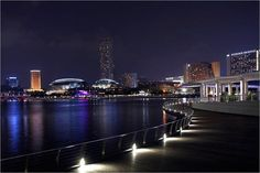 Walking along Marina Bay, soaking in the night view from the Singapore River.