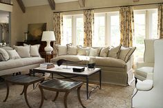 Loving the skirt on the sofa, you can tell it a down cushion, just look that the loft of it!