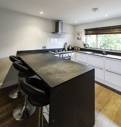 U shaped kitchen with slate worktops providing a unique design and contemporary feel.