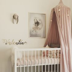Valentina's Nursery. Dusty pink canopy and gold stars by Numero 74. Bunny head with flower crown by Little Lops.