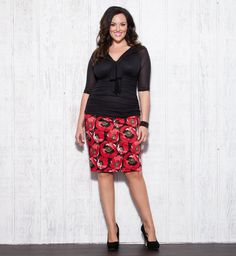 Spring has sprung in a bold, bright print.  Temper the red Poppy Pencil Skirt by Kiyonna with a black top for a simple, chic Spring ensemble.  We like it with unfussy black pumps and a fun, sparkly black bracelet. #plussize