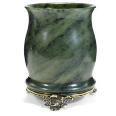 A Fabergé silver-mounted nephrite vase, workmaster Julius Rappoport, St. Petersburg, circa 1890, the body of baluster form, supported on ribbed band decorated with three foliate scroll feet. Provenance: Lady Deterding, née Lydia Pavlovna Kondoyarova. Lady Deterding was granted the title of Princess Donskaya in 1937 in recognition of her services to Russian émigrés