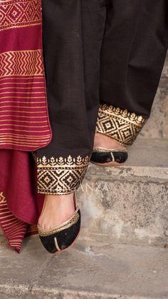 Black suit with block printed sleeves and neck line. Shalwar is having golden block print on panchas. Dress is paired with cherry maroon duppata with golden block print. Shawl color remain same maroon in all color suits Stylish Dresses For Girls, Stylish Dress Designs, Dress Clothes For Women, Designs For Dresses, Wedding Dresses For Girls, Pakistani Kurta Designs, Salwar Designs, Kurta Designs Women, Pakistani Dress Design
