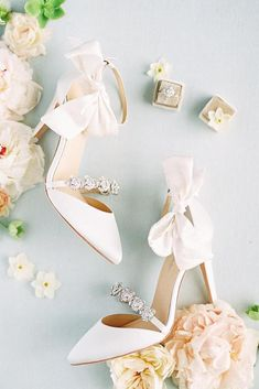 hochzeitsschuhe schlicht hochzeitsschuhe keilabsatz Liv Hart for Bella Belle collection. Olivia Ivory with silk bow and floral crystal ivory wedding shoes. 4 styles in 1 for versatility. Shop now! Converse Wedding Shoes, Wedge Wedding Shoes, Wedding Boots, Wedding Heels, Ivory Wedding, Bridal Shoes, Wedding Bride, Wedding Dresses, Blush Pink Wedding Shoes