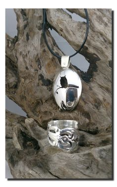 Owl in a silverspoon and a ring.