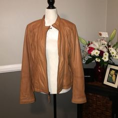 Gorgeous leather jacket It's soft like butter! Super cute zipper and snap detailing on the sleeves. Zip pockets. Worn only a few times. Camel/tan color. Black Rivet Jackets & Coats
