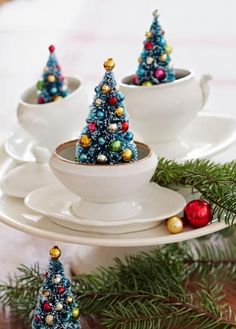 Idea we love! DIY mini trees in mustard pots. (Teacups work, too!) Details: http://www.midwestliving.com/holidays/christmas/6-ways-to-craft-a-merry-little-christmas/?page=3