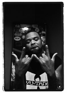 It's the #Method Man, for short Mr. Meth.  I can tell this motherfucker ain't #WU, look at his neck