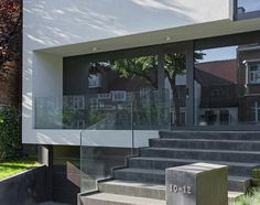House Decroly in Belgium blurs the line between inside and outside with obscured views and transparency.