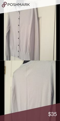 Very light gray cardigan, with detail on the back. Very, very light gray (almost pale blue or lavender) colored cardigan, with pretty stitching detail on the back.  New, never worn. Ann Taylor Sweaters Cardigans