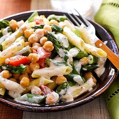 This meatless main-dish recipe practically overflows with asparagus, red pepper, pasta, and chickpeas. A spreadable herb cheese makes a creamy sauce for this 30-minute meal.