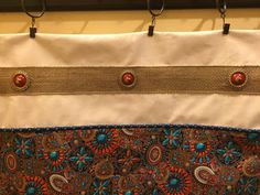 Curtains I made for my horse trailer living quarters. I like using the concho's.