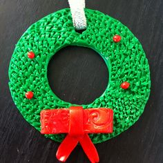 Christmas wreath ornament I made as a present using polymer clay