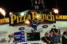 Chase Elliott scored his first career NASCAR victory in the annual East-West race at Iowa Speedway on May 19, 2012. Ryan Blaney, Chase Elliott, Nascar, Iowa, Victorious, Career, Racing, Running, Carrera