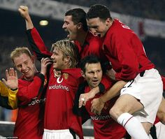Keane celebrates with one half of the Class of '92 as Ryan Giggs gives United a 1-0 lead a...