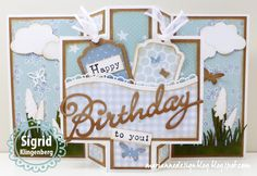 Handmade card by DT member Sigrid with Collectables Birthday (COL1349), Creatables Tiny's Grape Hyacinth (LR0402), Craftables Punch Die Butterflies (CR1354), Grass (CR1355) Basic Labels (CR1352) & Border Set Wave (LR0395) from Marianne Design