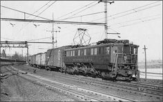 """P5-A """"Boxcab"""" 34704 hauls a mixed freight under the wires on the New York-Washington Main just before WWII."""