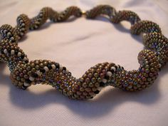 Victorian Spiral by AnnetteMackrel, via Flickr - using Aleta Ford Baker's Indespiral pattern