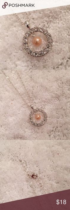 Silver Rhinestone Pearl Circle Pendant Necklace Catch the light with this sparkling silver necklace. Features a Rhinestone Circle with faux pale peach pearl center dangle charm.  *only 1 available. Jewelry Necklaces