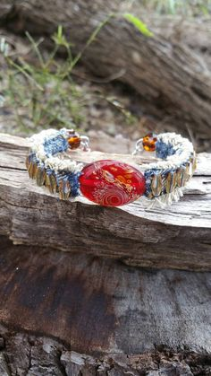 Check out this item in my Etsy shop https://www.etsy.com/listing/499437949/denim-cuff-bracelet-with-lampwork-beads