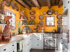 Kitchen of the Month, September 2012. Design: Judith Espinar, Jim Deville, and Scott Robey. Photo: Peter Vitale. housebeautiful.com. #kitchen #santa_fe #southwestern #pottery