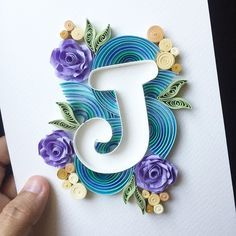 quilling art ... negative space J on top of a quilled montage ... Instagram photo by @miyyahatkertas via ink361.com