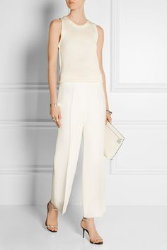 Calvin Klein Collection- high-rise waist allows for flattering cropped hem despite pleated front. Tonal top also helps lengthen look