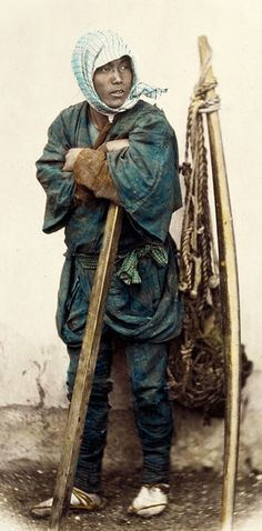 Coolie resting.  Hand-colored photo, 1870's, Japan.  Photographer Felice Beato