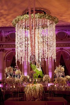 WOW! David Tutera I wonder how I can make the wagon wheel chandelier at our venue look more like THIS!