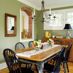 Sage Advice - Stained-wood or neutral-painted furniture fits easily into a room painted with a contrasting color. The sage green walls in this dining area balance the orange hues in the wood. The natural shade of green also complements the traditional cou Dining Room Sets, Green Dining Room, Green Rooms, Dining Area, Dining Table, Small Dining, Kitchen Colors, Kitchen Decor, Sage Kitchen